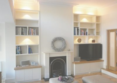 Living room - cupboards with vents - oak tops to match floor - contemporary box shelves