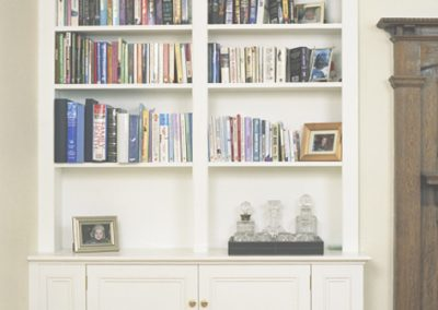 Living room - Victorian style panelled bookcase and cupboards for a wide alcove
