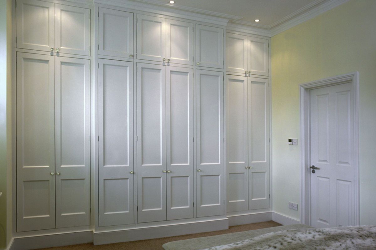 white fitted wardrobe with panelled doors