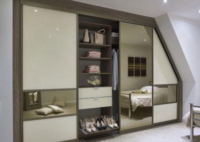 Wardrobe - angled contemporary sliding doors -  walnut effect finish - dressing mirror - interior shoe rack.
