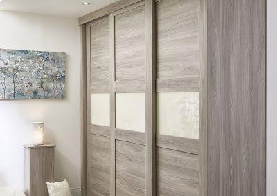 Wardrobe - sliding panel doors - oak wood effect finish