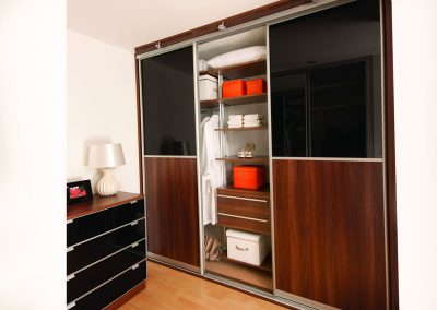 Wardrobe - contemporary sliding doors - glass and wood effect finish - adjustable interior framework