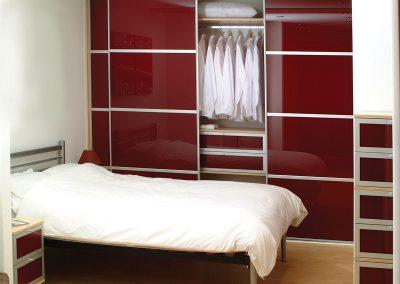 Wardrobe - contemporary sliding doors - dark red glass - matching interior drawers