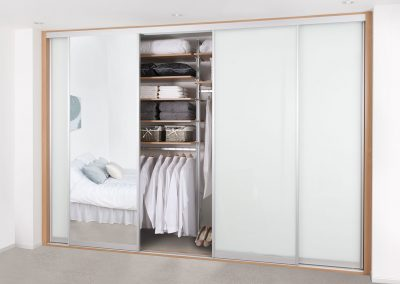 Wardrobe - contemporary sliding doors - white glass - dressing mirror - adjustable shelving and hanging rails