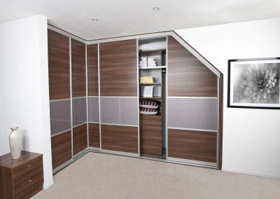 Corner wardrobe - angled contemporary sliding doors - walnut effect finish - matching interior drawers