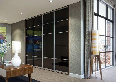 Wardrobe - contemporary sliding doors - black glass - decor bars