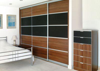 Wardrobe - contemporary sliding doors - black glass and walnut effect finish - matching drawers
