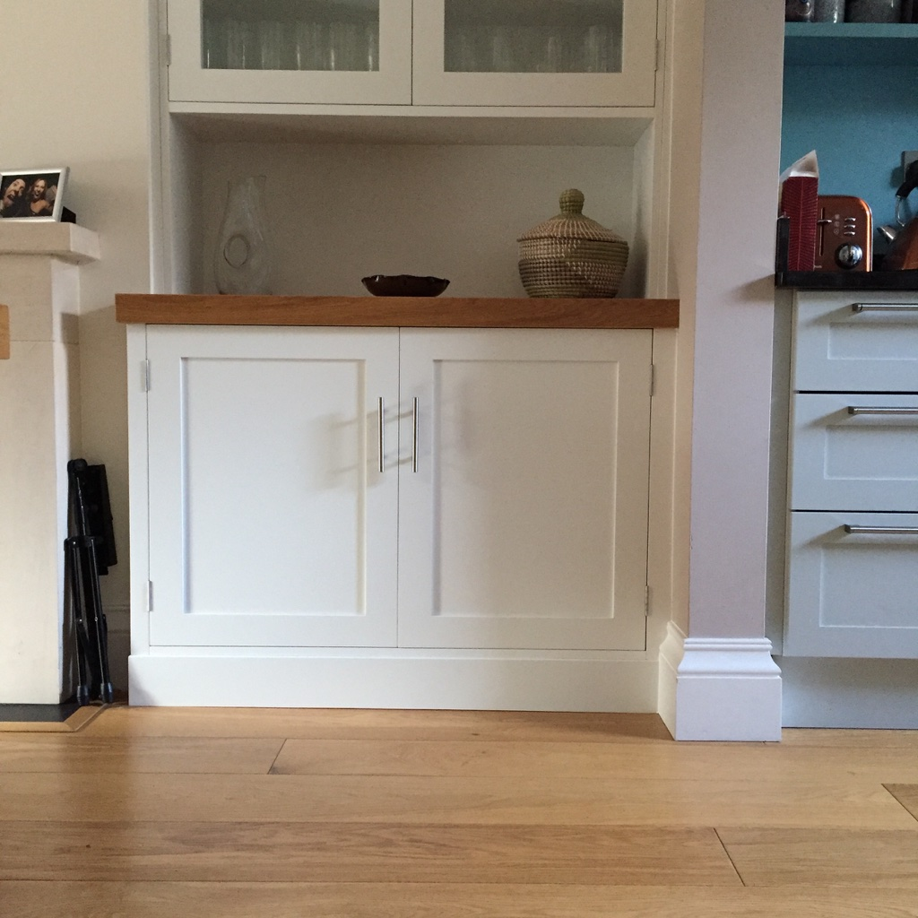 White cupboards with oak surface
